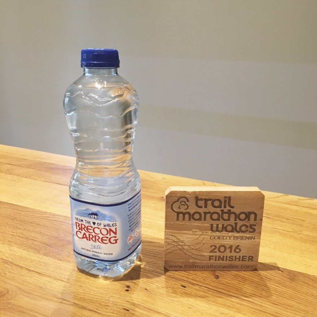 Tastes Brecon Carreg water and Trail Marathon Wales 2016 wooden coaster