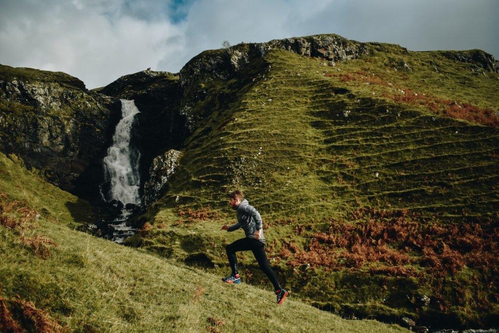 Ross running uphill at Fairy Glen on Skye