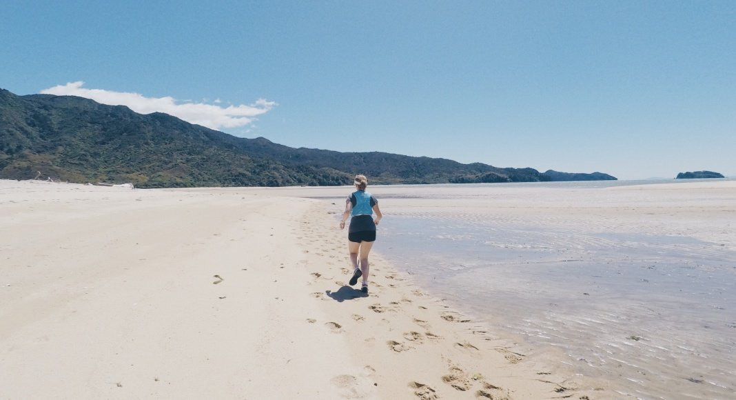 Trail running Abel Tasman National Park beach