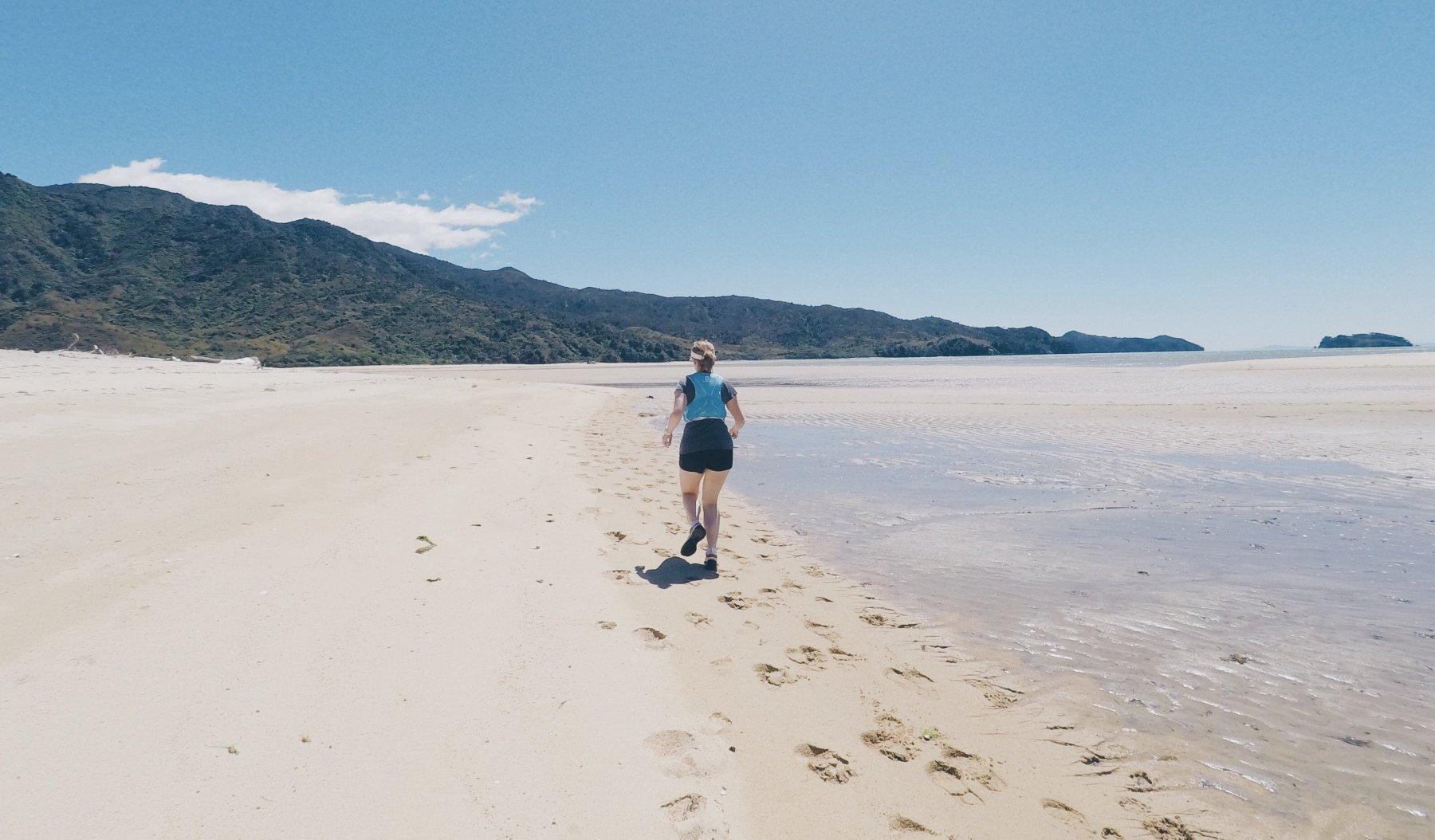 Trail running Abel Tasman National Park beach