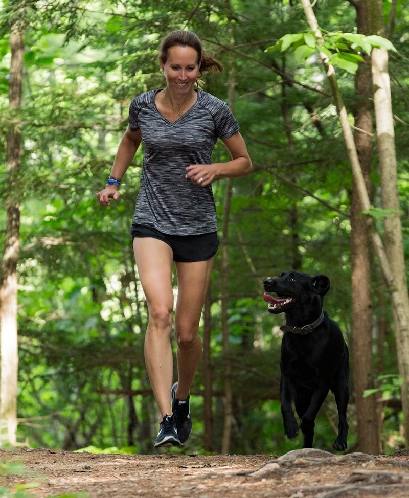 CBD For Dogs Austin and Kat - Kat and her very active senior dog Austin running together - Trail and Kale
