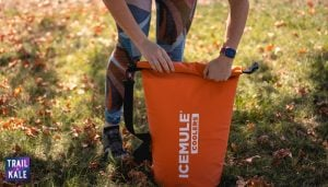 Helen demonstrating how to close the IceMule cooler so it achieves a waterproof seal   IceMule Cooler Review